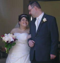Overjoyed Christian bride smiles at her new husband