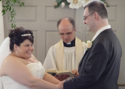 Happy Christians full of laughter as they exchange vows